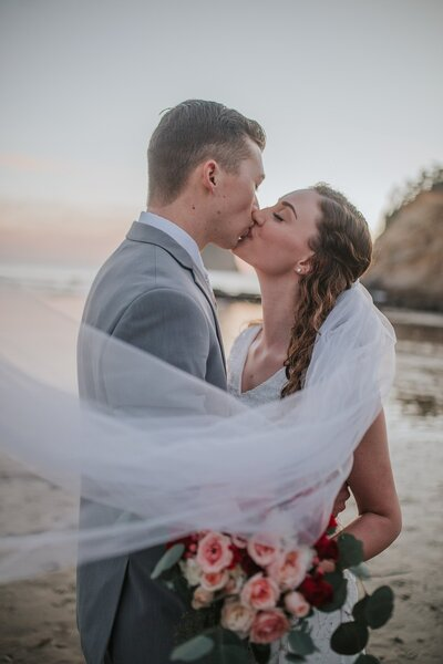 bride and groom kissing at outer banks for their elopement session