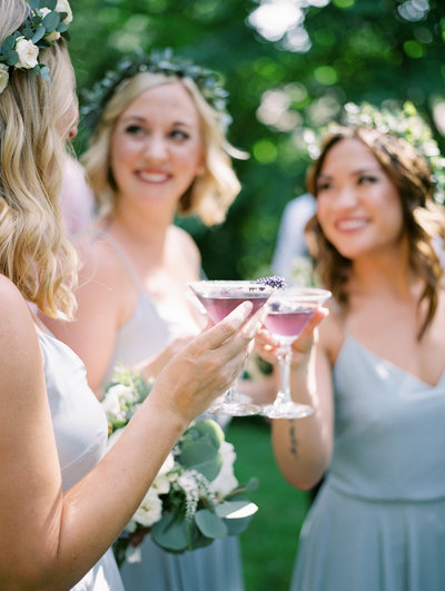 film photography of bridesmaids cheersing at an outdoor Oregon wedding