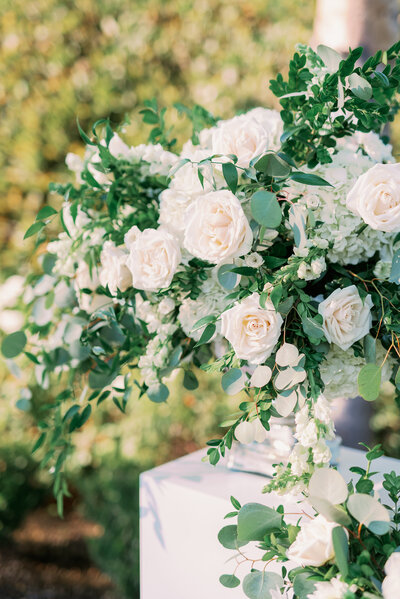 Classic white roses for wedding ceremony arch