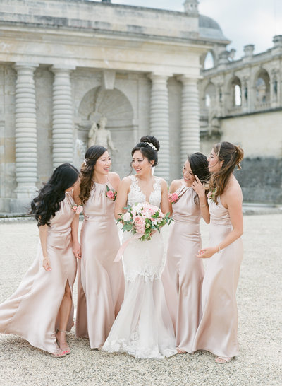 bridesmaids wearing jenny Yoo bridesmaids dresses at Chateau de Chantilly