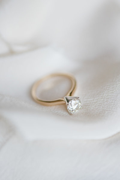 gold solitaire engagement ring