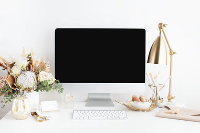 Desk with computer and feminine desk accessories