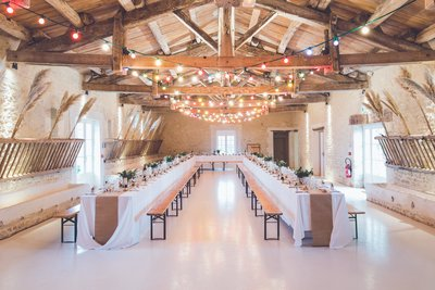 Indoor barn wedding venue with elegant decorations