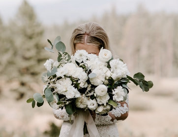 Lake Tahoe Wedding Planners bride holding beautiful white bouquet,  wedding at venue Mitchell's Mountain Meadows Sierraville near Truckee, Joy of Life Events image by The Shepards Photo