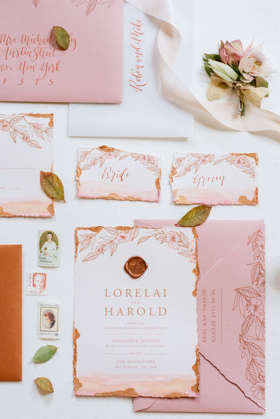 Dusty rose and copper invitation with deckled edges
