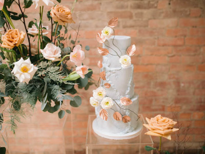 vintage stone wedding cake with romantic flowers