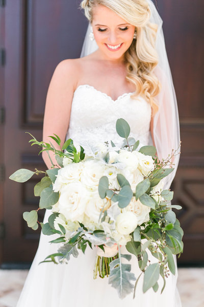 Garden Whimsical Bridal bouquet. dusty blue wedding. blue and grey wedding. tampa wedding planner. tampa wedding photographer. white wedding. bridal bouquet. chapel weddings