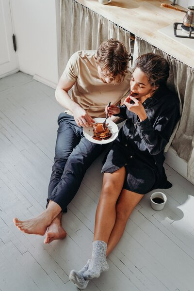two-person-eating-pancake-on-white-wooden-floor-3692876