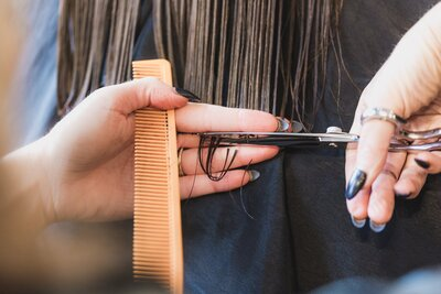 hands-cutting-long-brown-hair