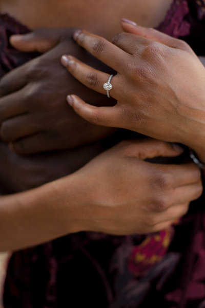 Engaged couple embraces hands for Atlanta Wedding Photographer Christina Bingham