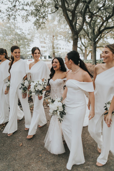 Elyse Jennings Weddings bride and bridesmaids in white jumpsuits