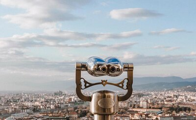 Binoculars looking over city to signify 12 places to find web design clients