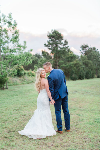 Bride in Lace Dress with Groom in Navy Blue Suit at Wingate Plantation Wedding