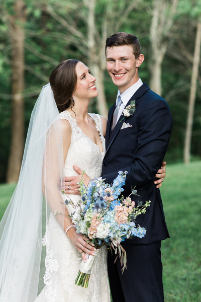 Bride and Groom Wedding Portrait with pastel floral bouquet