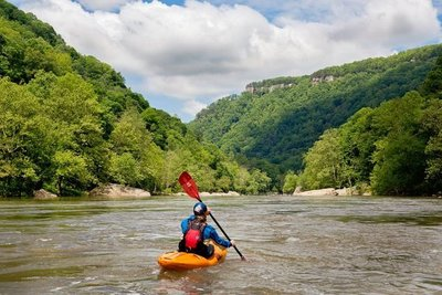 White water rafting and kayaking on the New River is one of many adventure activities in the New River Gorge area of WV.