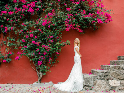 colorful bridal portrait against red wall