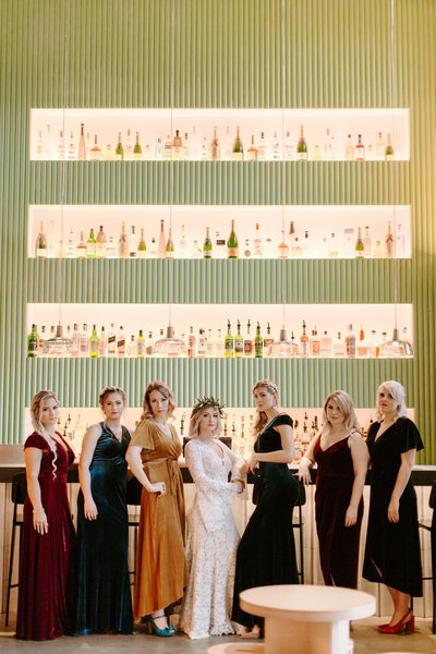 editorial bridesmaid portrait in front of bar