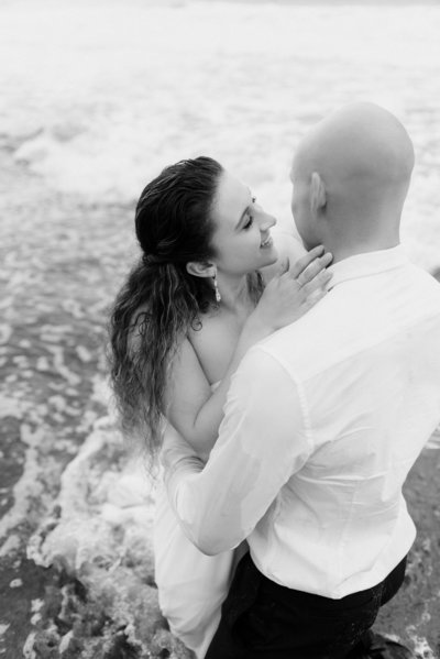 an adventurous couple getting married on a beautiful beach