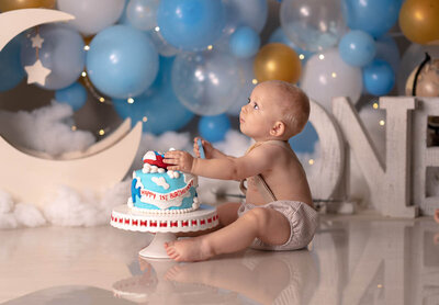 Little baby photoshoot with a birthday cake Orlando Florida