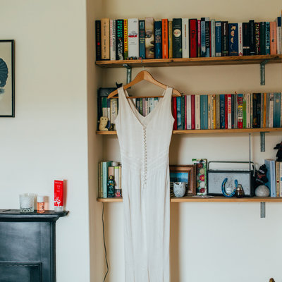 Alternative relaxed wedding dress photograph hanging on a bookcase