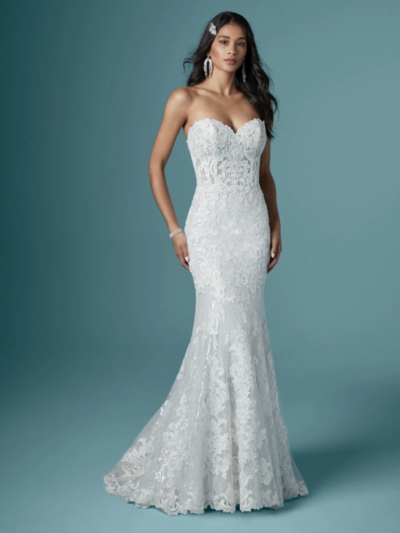 Mermaid Wedding Dress. Who knew a silhouette could make you look so svelte and poised? This sparkling mermaid wedding dress has all the right lines and all the right textures.