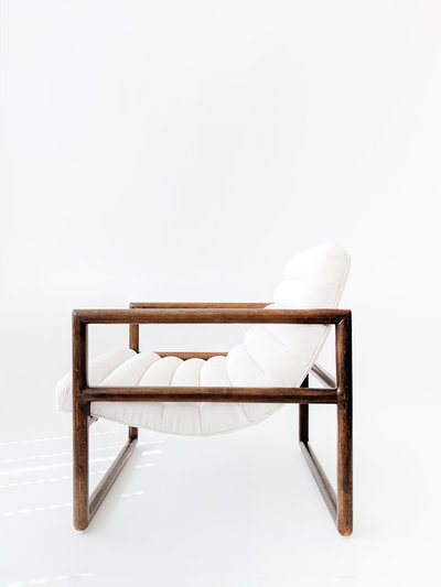white leather chair with walnut