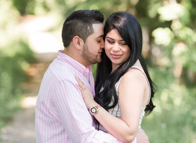 couple cuddling at their Williamsburg Va engagement session