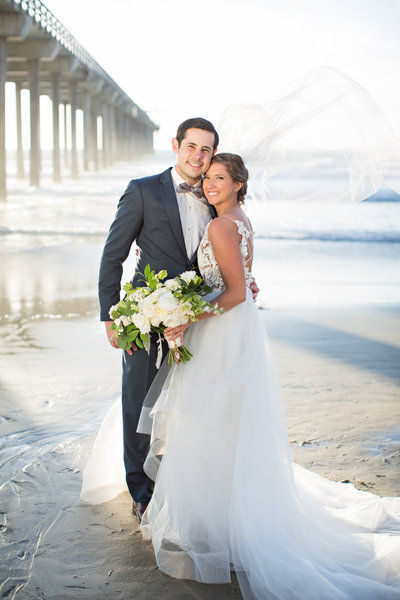 Bride and Groom on beach at their wedding at Scripps Seaside Forum