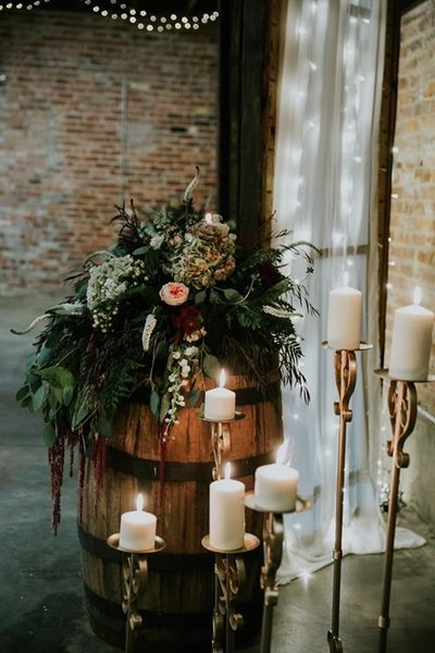 whiskey barrel, gold candles and cathedral window