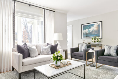 living room with light grey armchairs and beautiful white drapery
