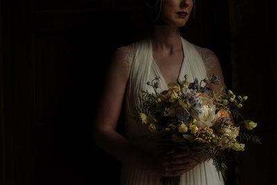 Bride with bouquet at East Riddlesden Hall. Modern wedding photogra[her yorkshire