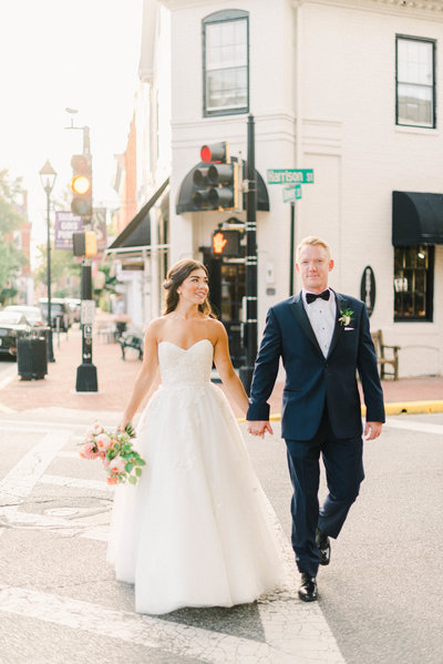 Bride and Groom walk city streets at Tidewater Inn wedding