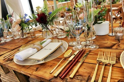 beautiful wooden table decorated by our cateringstaff