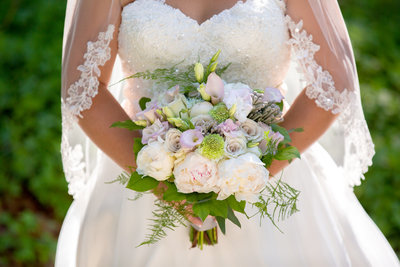 Purple white and green bridal bouquet