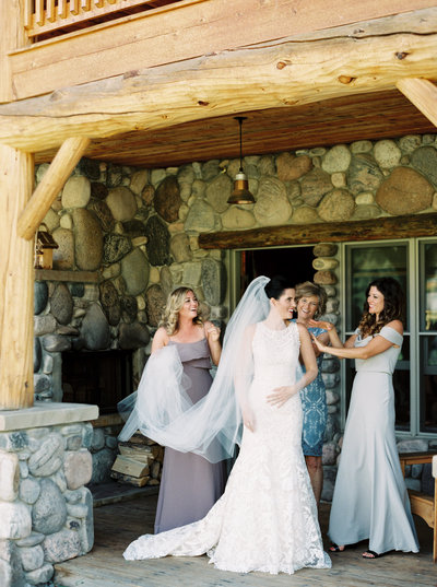 Bride with Bridesmaids Getting Ready at Rainbow Ranch in Big Sky Montana