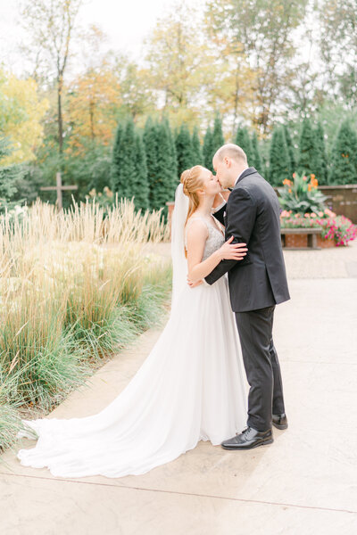 Bride and groom kiss fall wedding