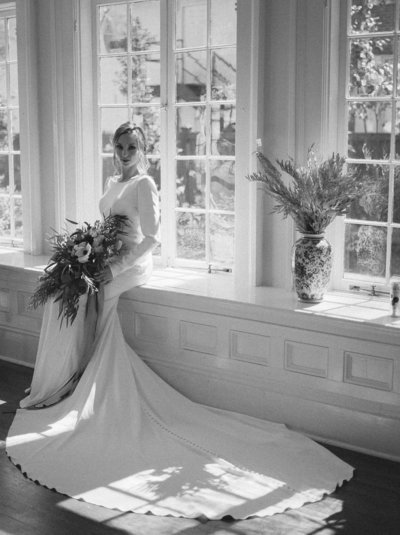 Bride sitting on window sill at 255 Milledge in Athens Georgia