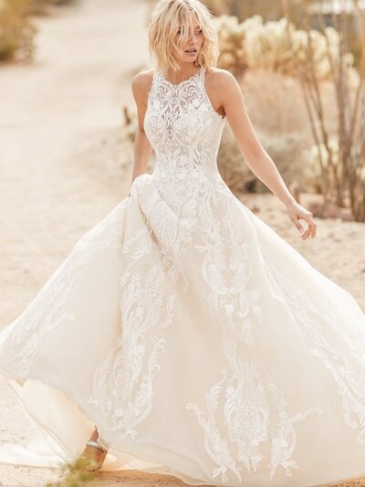 Halter Ball Gown Wedding Dress. Whoever says princesses have no place on the beach we simply will not tolerate. Presenting this halter ball gown wedding dress for easy-breezy-regal vibes.