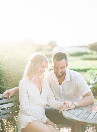 Engaged couple portrait at Napa winery vineyard,  sunlit outdoor fine art photo, shot in film by Evonne and Darren, Chateau St. Jean Winery elegant wedding venue in Kenwood, Sonoma California Wine Country