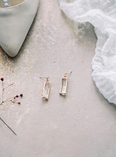 Luxury bridal earrings flatlay