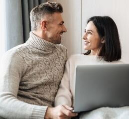 "A couple reading an article ""How to get an expert to help your relationship?"""