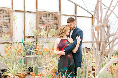 Engaged couple at Harveys greenhouse in Adel, Ia