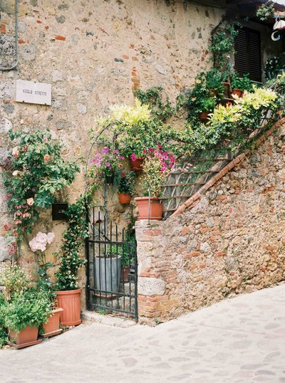Image of streetcorner in Monteriggioni. Fine art travel film photography by Rosie Reports.