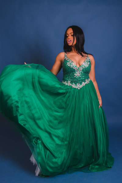 African American Woman in Green Prom Dress with Blue Background
