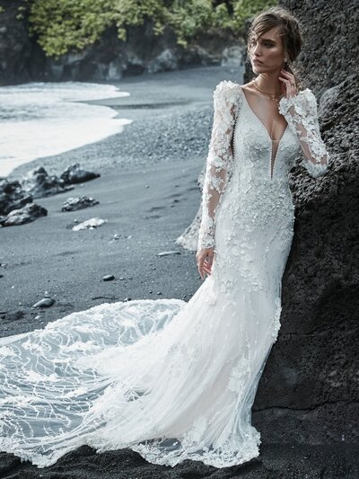 Vintage Puff Sleeve Mermaid Wedding Dress. There's a lot to love in a vintage lace mermaid wedding dress, but just a reminder that 3D florals make for particularly dazzling photo ops.