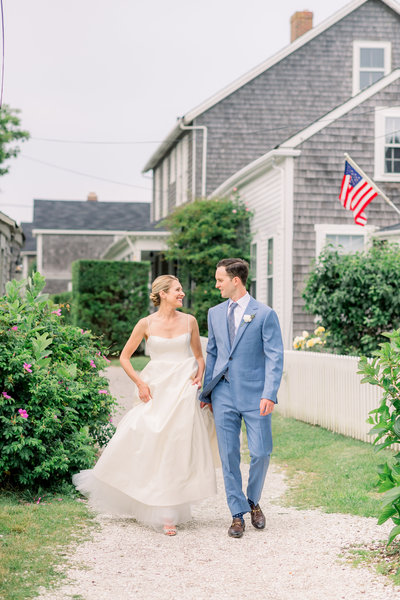 Phoebe and Sam walking through Sconset for bridal portraits