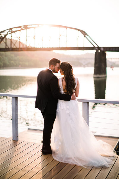 Bride and groom embrace on dock at Riverfront Wedding Venue in Pittsburgh PA