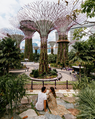 man and woman sitting at gardens by the bay singapore