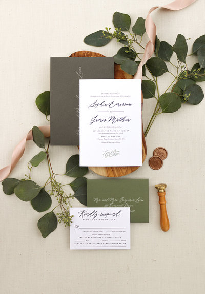 A subtle watercolor eucalyptus leaf adorns the bottom of the invitation. Paired with beautiful typography and modern calligraphy, this invitation is perfect for any wedding.