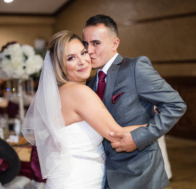 Hispanic Groom Kissing Hispanic Bride on the Cheek